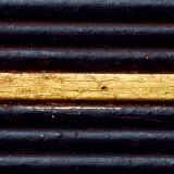 holzmuster-schwarz-patiniert-mit-gold-149